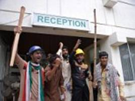 Anti-government protesters storm Pakistan state television station and 'beat journalists'